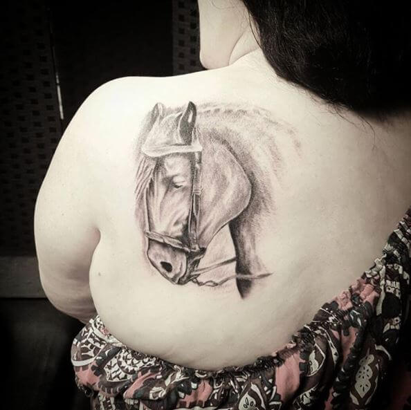 Black And Grey Horse Tattoo On Back