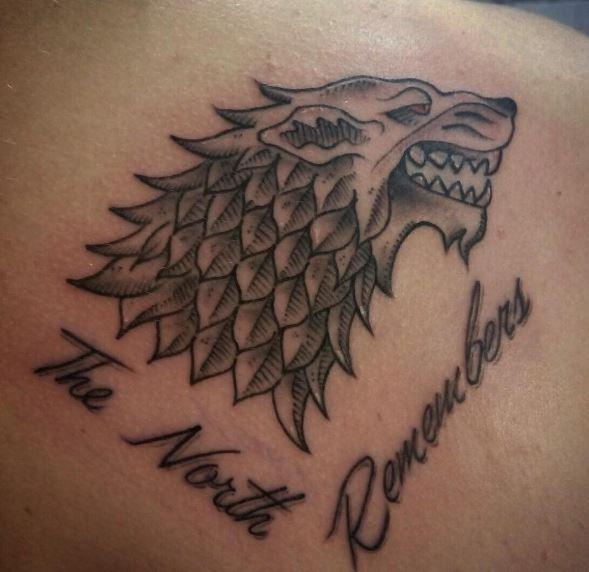 Lion Tattoos Design On Upper Back Side