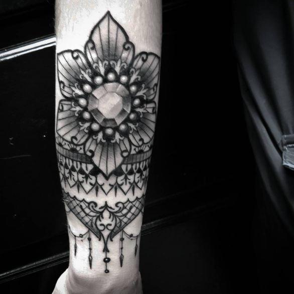 Black Feminine Tattoos On Arm