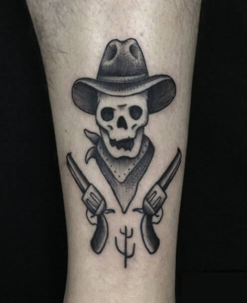 Skull And Guns Tattoo