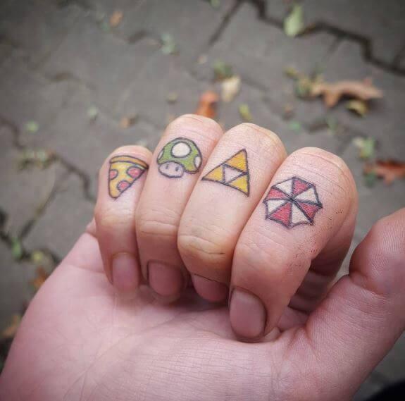 Zelda Knuckle Tattoos
