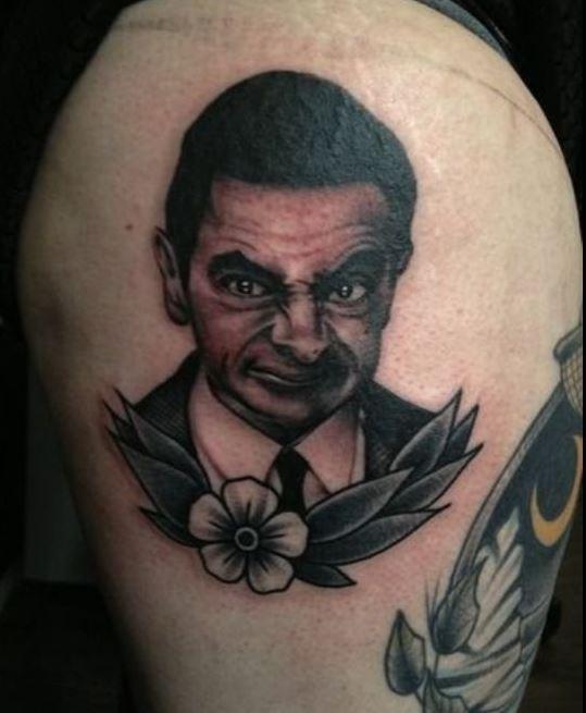 Funny Bad Tattoos Design On Thigh