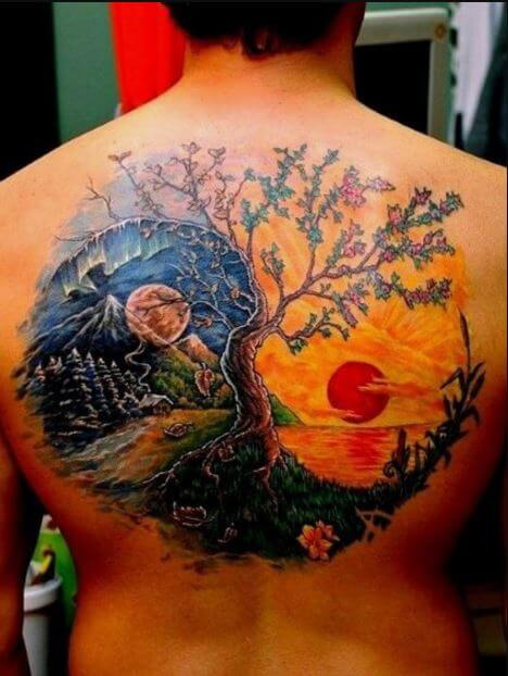 Guys Sun And Moon Tattoo On Back