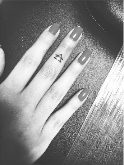 Small Glyph Tattoos Design On Middle Fingers