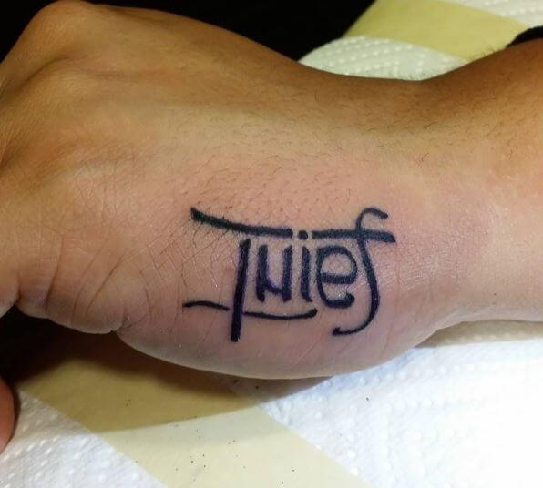 Thief Ambigram Tattoos On Hands