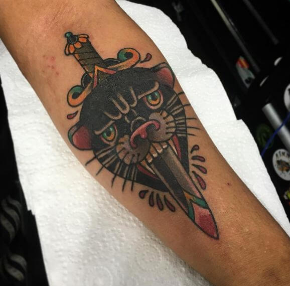 Black Panther With Dagger Tattoos