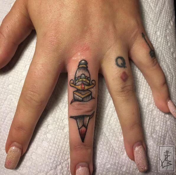 Dagger Tattoos On Finger