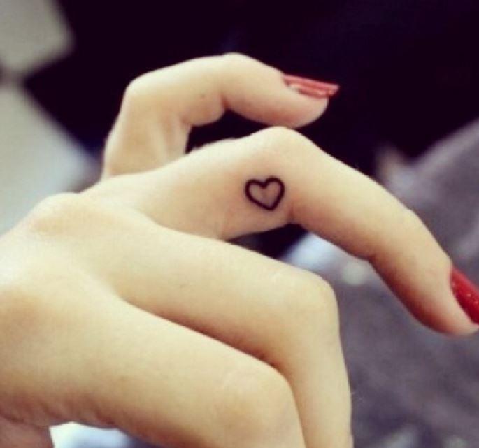 Side Finger Tattoos
