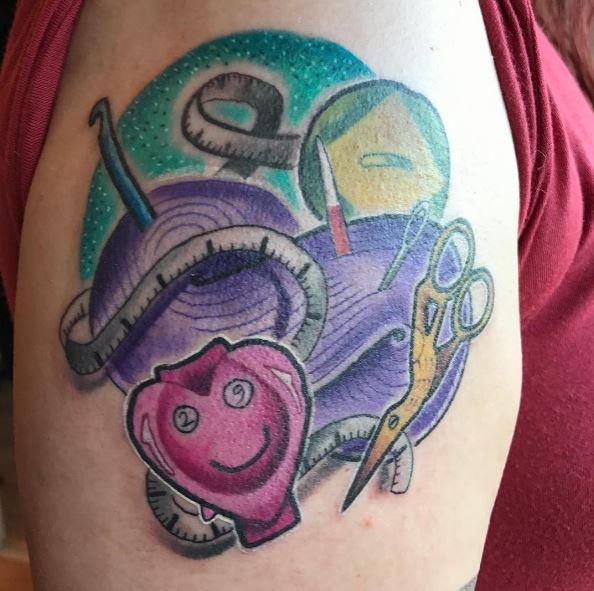 Beautiul Knitting Tattoos Design On Biceps