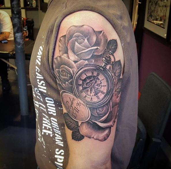 Clock Watch And Floral Tattoos Design On Biceps