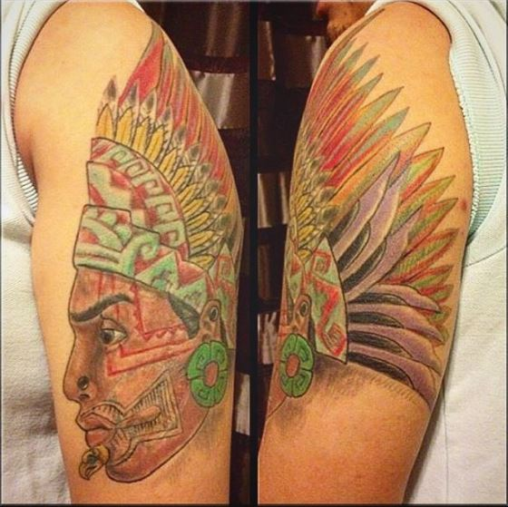 Colored Aztec Tattoos Design On Biceps