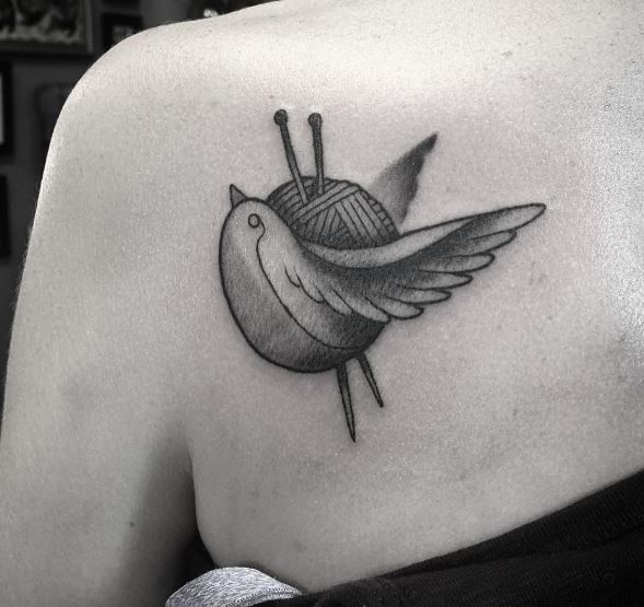 Little Knitting Tattoos Design On Upper Back Shoulder