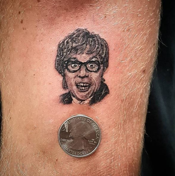 Micro Man Face Tattoos Design On Legs