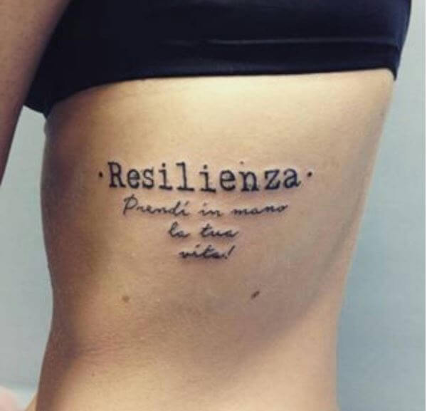 One Word Tattoos Design On Ribcage