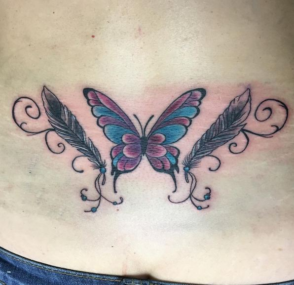 Feather And Butterly Lower Back Tattoos