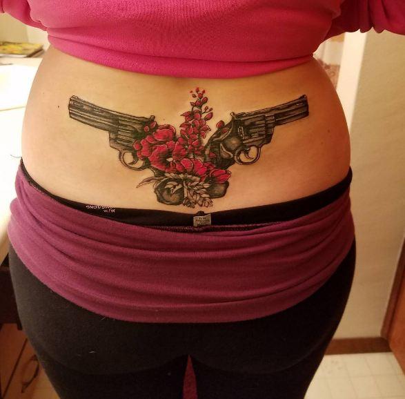 Gun Lower Back Tattoos