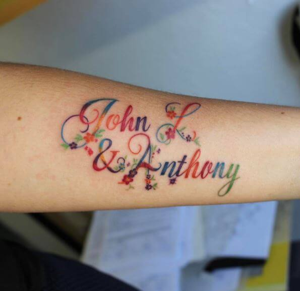 Colorful Name Tattoo Design On Forearm