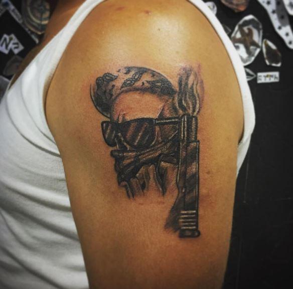 Gangsta Tattoos Design On Biceps