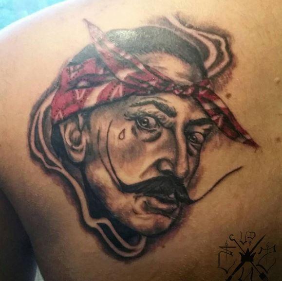 Gangsta Tattoos Design On Upper Backside
