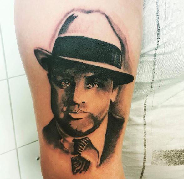 Gangster Face Tattoos Design On Biceps