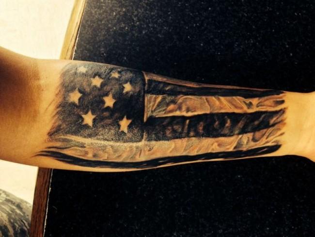 Black Realistic US Flag Tattoo On Forearm