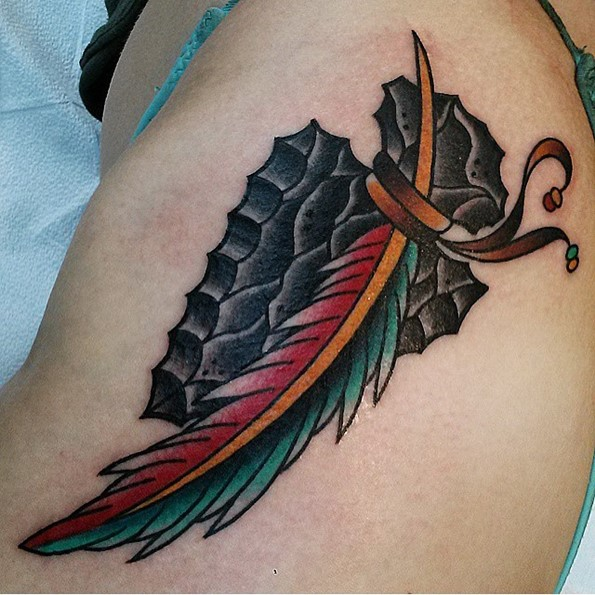 Cool Arrowhead Feather Tattoo On Thigh