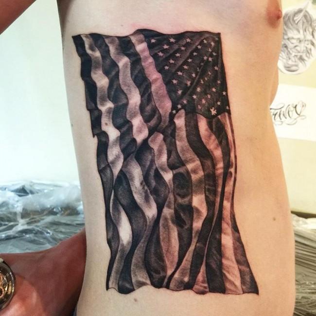 Flying Black US Flag Tattoo On Side Rib