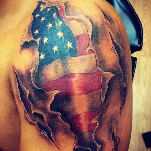 Ripped American Flag Tattoo On Shoulder
