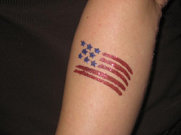 Small Glittering US Flag Tattoo On Arm Sleeve