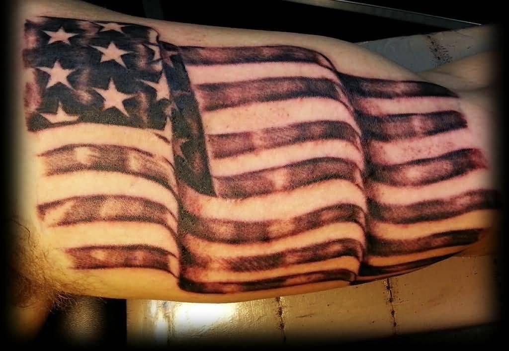 Superb Patriotic US Flag Tattoo On Biceps