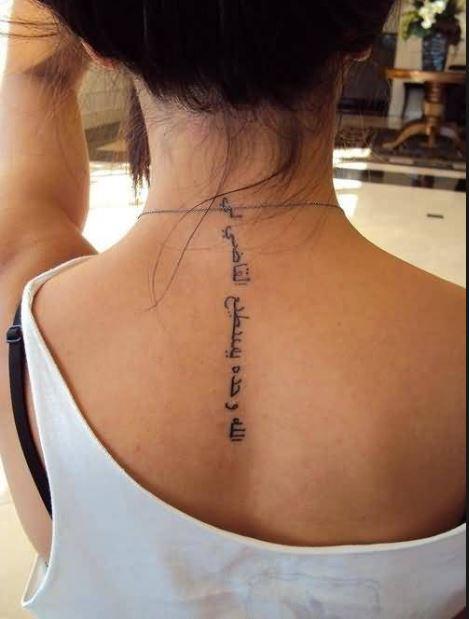 Great Looking Arabic Letter Tattoo On Women's Upper Back
