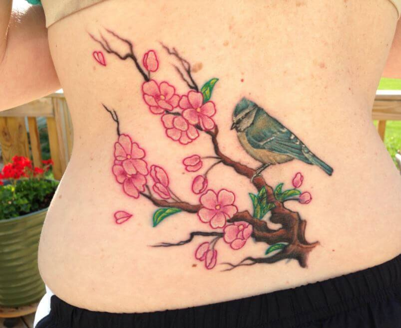Lower Back Coverup Tattoos For Girls