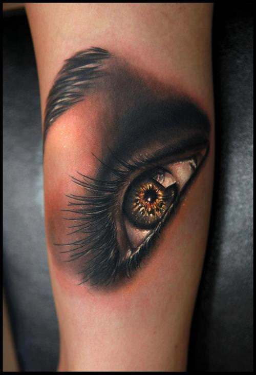 A Stunning Photo Realistic Tattoo Of An Eye By Rich Pineda With Gold Tones And Smoky Shadows