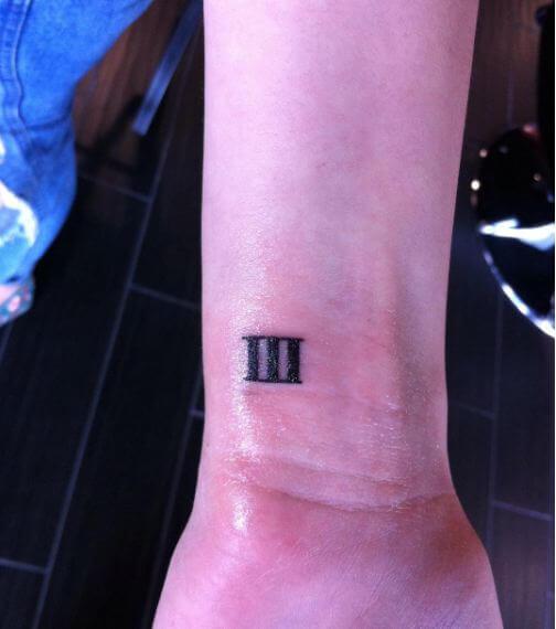 Tiny Roman Numeral Tattoos