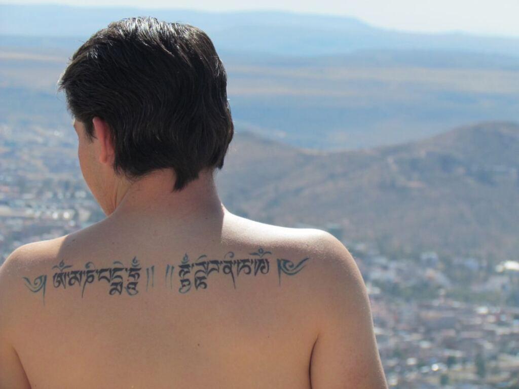 Om Mani Padme Hum Back Tattoo